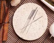 Acupuncture needles on a plate image