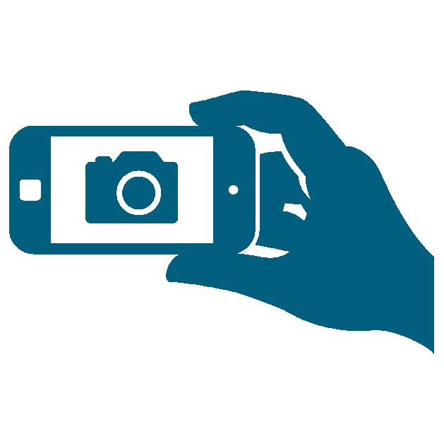 A hand, holding a phone with camera logo on screen