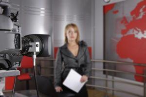 unrecognizable television news reporter and video camera