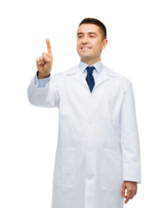 smiling male doctor in white coat pointing finger
